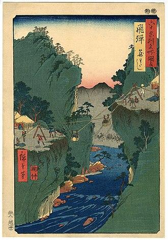 "Hida Province - Hiroshige ukiyo-e ""Hida"" in ""The Famous Scenes of the Sixty States"" (六十余州名所図会), depicting a suspension bridge"