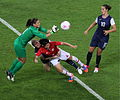 Hope Solo punches ball, Rachel Buehler takes down Saki Kumagai.jpg