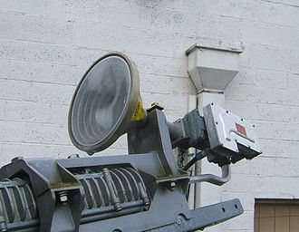 Feed horn - Corrugated feed horn and LNB on a Hughes DirecWay home satellite dish.