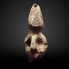 Human head with pyramidal headress