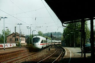 Sankt Ingbert station - An Intercity-Express train passes through the station. The only services that stop here are shorter-distance regional services. The old station building is on the left.