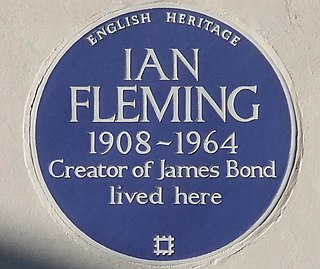 Blue plaque marker commemorating a link between a location and a person or event