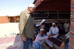 Hispanic and Latino American Muslims - Yusef Maisonet, Imam of Masjid AsSalaam in Mobile, Alabama giving a Friday sermon in the desert between Abu Dhabi and Al Ain UAE in 2007.