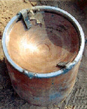 Improvised explosive device in Iraq. The concave copper shape on top is an explosively formed penetrator.