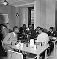 In the basement restaurant of the Colonial Centre at 17 Russell Square, London, civilians from Sierra Leone enjoy a meal, 1944. D20011.jpg