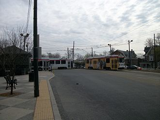 63rd Street and Malvern Avenue station - Two trolleys and a SEPTA bus within the loop