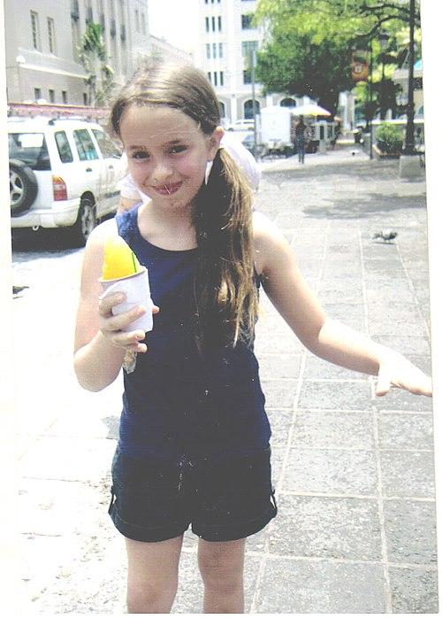 Girl holding piragua