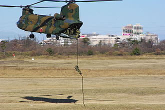 1st Airborne Brigade (Japan) - 1st Airborne Brigade paratroopers fast rope from a Kawasaki CH-47 chopper during a public exhibition at Camp Narashino.