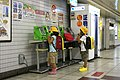 Japanese children using public phones.jpg