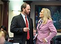 Jayer Williamson and Heather Fitzenhagen confer on the House floor.jpg