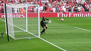 Jens Lehmann - Lehmann diving to save a shot during a warm-up.