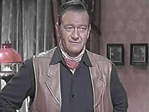 English: John Wayne in McLintock! (cropped scr...