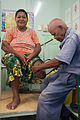 Jospeh Sodiasi fitting a patient Vele who lost her leg to diabetes at the National Orthotic & Prosthetic Services (NOPS), Port Moresby General Hospital, PNG. (10705852345).jpg