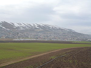 Joub Jannine - Joub Jannine. January 2015. Refugee camps in foreground.
