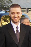 Justin Timberlake in a suit smiling.