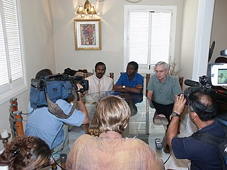 Guy Philippe - K. A. Paul with Haitian rebel leader Guy Philippe and Former US Congressman Bob Clement, at a press conference in Haiti after Paul convinced Phillipe to lay down his arms following Haitian President Jean-Bertrand Aristide's deposition