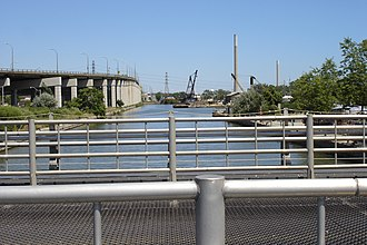 Keating Channel - Channel, looking east from Cherry St. The channel ends about 5 m behind the camera's viewpoint, the Don River entering in the far background.