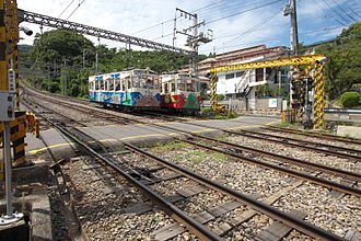 Ikoma Cable Line - Motorable level crossing at the passing loop of Hōzanji Line
