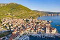 Komiza Town Harbour with a view to St. Nicholas Church on Vis island, Croatia (48608316418).jpg
