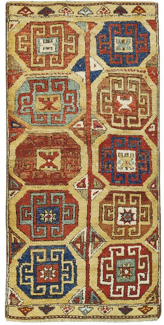 Gul (design) - Konya 18th carpet with Memling gul design. There is a row of triangular amulet motifs (Muska) at top and bottom; each of the four lower guls has a star motif (Yıldız) at its centre.