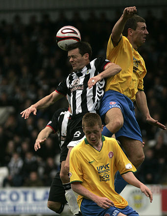 A player (black white) being challenged by two defenders (yellow blue e2843c0dfd90