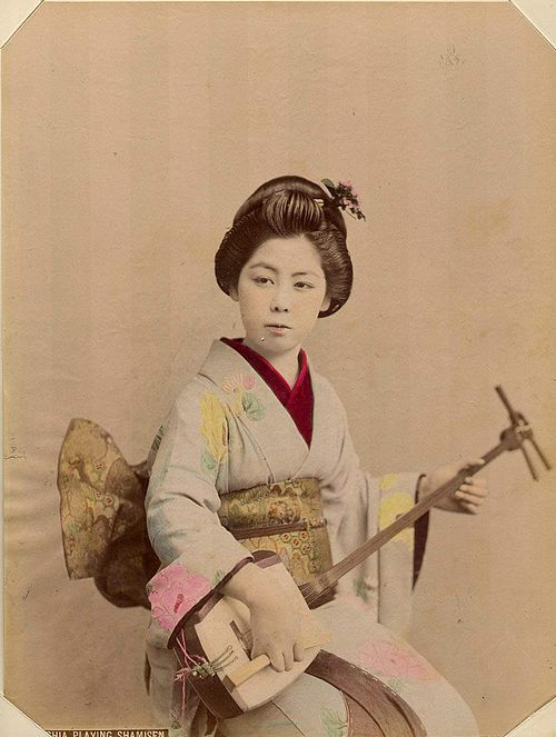 Kusakabe Kimbei - 146 Geshia Playing Shamisen.jpg