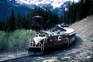Colorado and Southern Railway - An excursion train of the Leadville, Colorado and Southern stops at the French Gulch tank