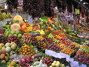 Cuisine - A wide variety of fruits and vegetables at the La Boqueria, a public market in the Ciutat Vella district of Barcelona, Spain