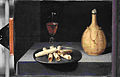 La nature morte, dite Le Dessert de gaufrette, signée Baugin et conservée au Musée du Louvre.jpg