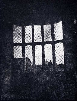 A latticed window in Lacock Abbey, England, photographed by William Fox Talbot in 1835. Shown here in positive form, this may be the oldest extant photographic negative made in a camera. Latticed window at lacock abbey 1835.jpg