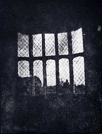 A latticed window in Lacock Abbey, England, photographed by William Fox Talbot in 1835. Shown here in positive form, this may be the oldest extant photographic negative made in a camera. - Photography