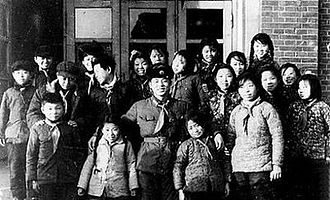 Lei Feng - Lei Feng with a group of primary school students in Fushun. He used his spare time to help the students with their extracurricular activities.
