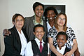 Leslie Meek with Miami family.jpg