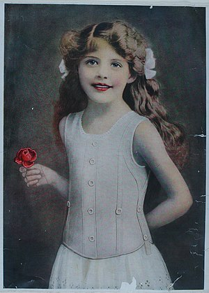 Liberty bodice - Freda Cox wearing a Liberty bodice in an early advertising photograph for Symington, published between 1908 and 1910.