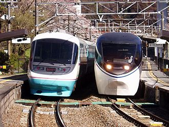 371 series - 371 series (right) and Odakyu 20000 series RSE (left) EMUs on Asagiri services, April 2008
