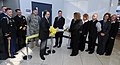 Linda Kozma, foreground, and Franco Tedeschi, foreground left, participate in the ribbon-cutting ceremony at the grand opening of the USO cyber canteen in the secure side of the American Airlines terminal at 101210-N-IK959-117.jpg