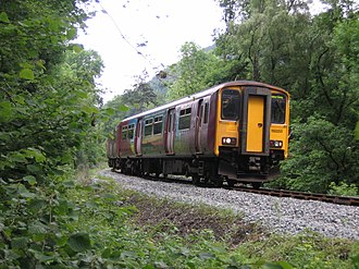Conwy Valley line - 150253 heading into the Lledr Valley in the Summer of 2007. This unit has now been repainted into Arriva's standard livery.