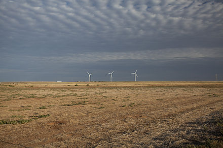Wind turbines on the windswept high plains of the Llano Estacado, Lubbock County, Texas. Lubbock County Texas wind turbines 2011.jpg