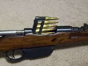 Clip (firearms) - An en bloc clip of 8x56mmR is inserted into a Steyr M95 carbine.