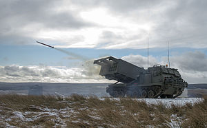 MLRS captured as a training round leaves the launch tube on the ranges at Otterburn. MOD 45158570.jpg