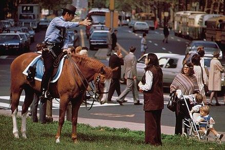 Mounted police officer in Center City, 1973 MOUNTED POLICEMAN ON BUSY DOWNTOWN THOROUGHFARE - NARA - 552732 b.jpg