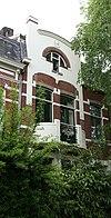 foto van Herenhuis in een door de Art Nouveau beïnvloede eclectische bouwstijl.