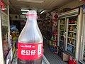 Macau 告利雅施利華街 Rua Correia da Silva Mercearia Kei Tac shop Oct-2015 DSC plastic bottle Cake label.JPG