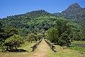 Main path lined with stone pillars to the ruined Khmer Hindu temple of Wat Phou, Champasak, Laos.jpg