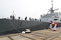 Malaysian sailors handle lines as the littoral combat ship USS Freedom (LCS 1) arrives in Kuantan, Malaysia, in support of Cooperation Afloat Readiness and Training (CARAT) 2013 June 15, 2013 130615-N-YU572-212.jpg