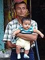 Man with Baby - Rio Dulce - Izabal - Guatemala (15701198537).jpg