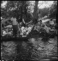 Manzanar Relocation Center, Manzanar, California. Family groups enjoying the mountain creek which f . . . - NARA - 538078.tif