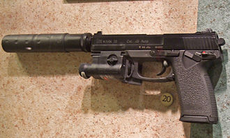 Heckler & Koch Mark 23 - MARK 23 equipped with suppressor and laser aiming module.