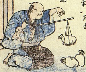 "Osaki - ""Osaki-gitsune"" (尾崎狐) from the Kyōka Hyaku Monogatari by Masasumi Ryūkansaijin. The face of osaki peak out from the bosom and the left sleeve of the man holding the balance."