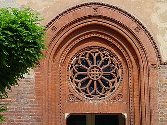 San Cristoforo sul Naviglio - The Gothic portal with rose window.